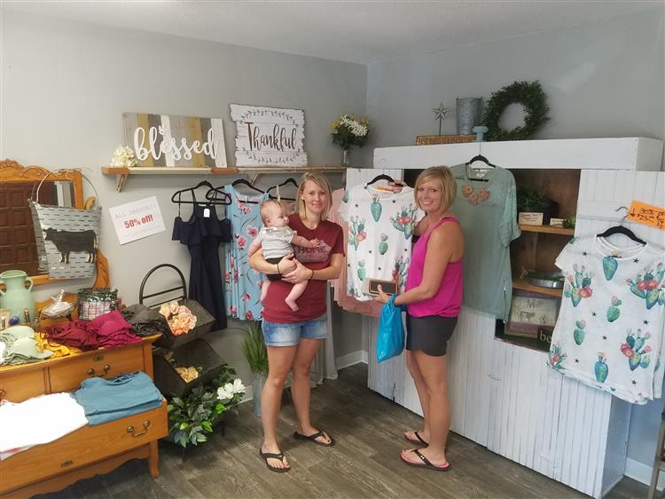 Picture of shoppers at boutique